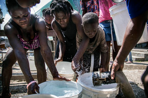 On 12 October 2016 in Jérémie, Haiti, women and children fill buckets with clean water. A tanker truck in the area provides chlorine-treated spring water to temporary shelters for the displaced. ACTED, a UNICEF implementing NGO-partner, is working in partnership with the national water branch, DINEPA, to ensure the purification of the water delivered. Hurricane Matthew passed over Haiti on Tuesday October 4, 2016, with heavy rains and winds. While the capital Port au Prince was mostly spared from the full strength of the class 4 hurricane, the western area of Grand Anse, however was in the direct path. The cities of Les Cayes and Jeremie received the full force sustaining wind and water damage across wide areas. Coastal towns were severely damaged as were many homes in remote mountainous regions. International relief efforts are underway to provide food water and shelter to the people affected by the storm. An estimated 500,000 children live in the Grande Anse Department and Grand South Department in southern Haiti, the areas worst hit by Hurricane Matthew. UNICEF had prepositioned emergency supplies with national authorities to reach up to 10,000 people. On 8 October, six water trucks arrived in Jeremie and Les Cayes, the respective capital cities within the Departments. Additional water and sanitation supplies, such as water purification tablets, water bladders and plastic sheeting, have been dispatched to the most affected departments in the westernmost tip of Haiti. As of 10 October, UNICEF delivered blankets, buckets, water purifying equipment and cholera diagnostic kits. UNICEF is working to reinforce good hygiene practices, especially in temporary shelters, in order to minimize the outbreak of disease. An investigation is underway to confirm the areas affected by cholera, and to determine the cross-over with hurricane-affected areas.